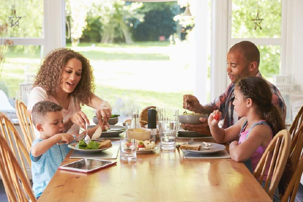 A family enjoys mealtime at the table.